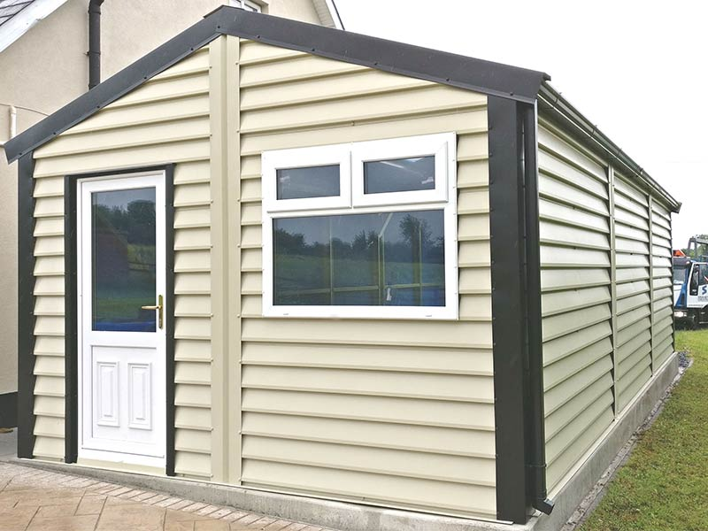 9.2m x 5m Silver Range with Mushroom Plank Effect upgrade and roller door to the back Shanette Sheds