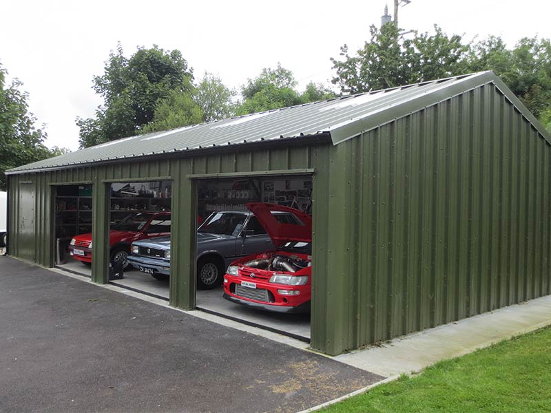 12.2m x 7m Gold Range garage with vertical profile cladding with 3 roller doors