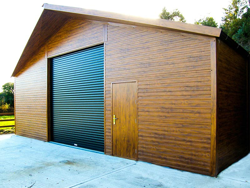 40' x 30' Gold Range unit with Golden Oak flat panel, 10' walls and pointed overhang Shanette Sheds