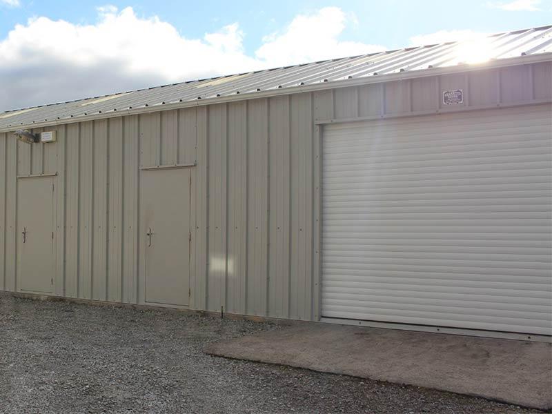 15.2m x 7m Gold Range garage with Mushroom vertical cladding, roller on side & 2 steel doors Shanette Sheds