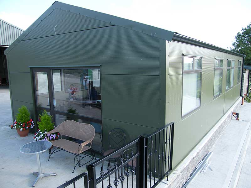 Insulated office unit with archtechural flat panel